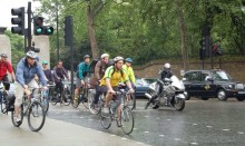 Many cyclists on busy city road