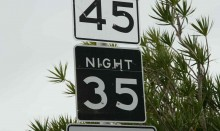 Speed limit sign with different speeds for day and night