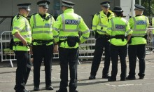 Six police officers in high-vis jackets talking