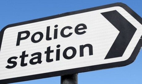 Police station road sign